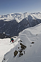 Austria, Man skiing on snowcapped mountains - FF001336
