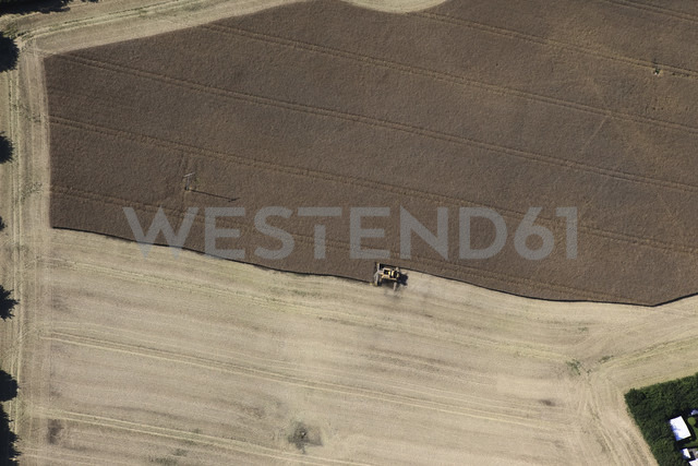 Germany, View of  harvester on fields at Hartenholm - FB000007 - Frank Blum/Westend61