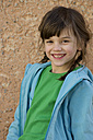 Germany, Tuebingen, Portrait of girl, smiling, close up - LV000022