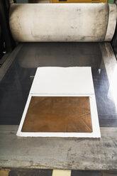 Germany, Bavaria, Copperplate printing in print shop - TC003416