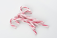 Candy canes on white background, close up - ASF004924