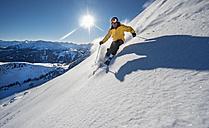Austria, Salzburg, Mature man skiing in mountain of Altenmarkt Zauchensee - HHF004571