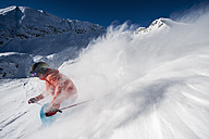 Austria, Salzburg, Young man skiing in mountain of Altenmarkt Zauchensee - HHF004563