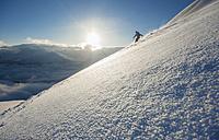 Austria, Salzburg, Mid adult man skiing in mountain of Altenmarkt Zauchensee - HHF004597