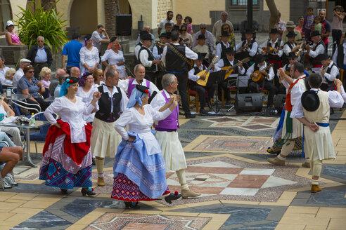 Spain, Dancers dancing in Canarian village - MAB000008