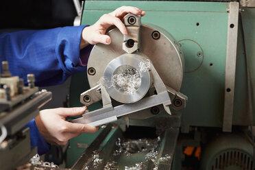Germany, Kaufbeuren, Woman working in manufacturing industry - DSC000076