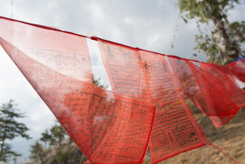 Bhutan, Red prayer flags hanging at Wangditse Temple - HL000140