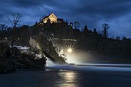 Switzerland, Schaffhausen, View of waterfall at dusk - EL000004