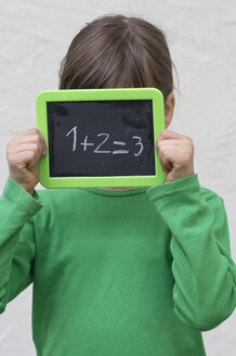 Girl holding blackboard with numbers - LVF000061