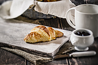 Croissants and jam on wooden table, studio shot - SBDF000185