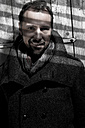 Portrait of mature man leaning on door - MAE006534