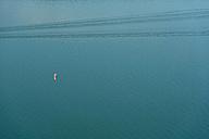 Germany, Navigation mark and trail of boat on Lake Constance - SH000705