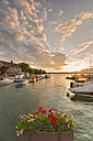 Germany, Flower pot in front of Lake Constance and half timbered house in background - SH000692
