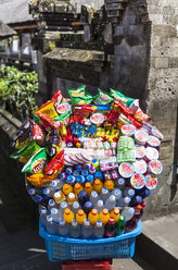 Indonesia, Offer of food and drinks kept for tourist at Pura Penataran Agung temple - AM000093