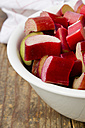 Bowl of rhubarb on wooden table, close up - LVF000070