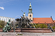 Germany, Berlin, View of Neptunbrunnen fountain with Saint Marys Church in background - CB000069