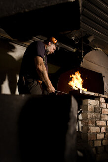 Blacksmith at work at the fireplace - CNF000054