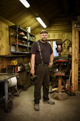 Portrait of confident craftsman in his workshop - CNF000081