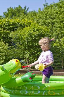 Germany, Kiel, Girl in paddling pool - JFEF000107