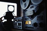 Germany, Bavaria, Man with head phone in recording studio - DSC000083