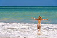 USA, Florida, Mature woman running on beach - ABAF000857