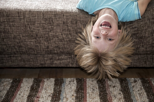 Austria, Boy lying on couch - CWF000050