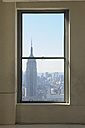 USA, New York State, New York City, View to Empire State Building through window - RUE001067