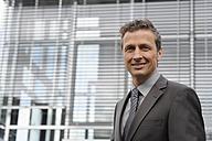 Germany, Bavaria, Munich, Portrait of businessman, smiling - CR002418