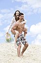 Germany, Bavaria, Young man giving piggy back ride to woman - MAEF006745