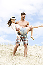 Germany, Bavaria, Young man carrying woman, smiling - MAEF006746