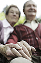 Germany, Cologne, Senior couple holding hands in park - JAT000076