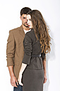 Young couple against white background, close up - MAEF006781