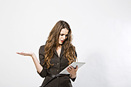 Businesswoman using digital tablet, close up - MAEF006796