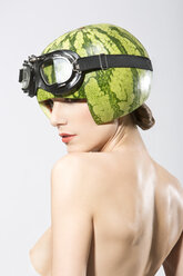 Young woman wearing watermelon helmet, close up - MAEF006818