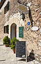 Spain, Mallorca, Menu board outside cafe at village Deia - AM000216