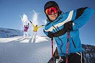 Austria, Salzburg, Young man and women having fun in snow - HH004618