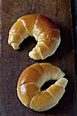 Butter croissants on wooden chopping board, close up - CSF019383