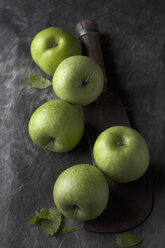 Green apples with sickle, close up - CSF019344