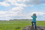 Germany, Mecklenburg Vorpommern, Boy playing with mosquitoes - MJ000175