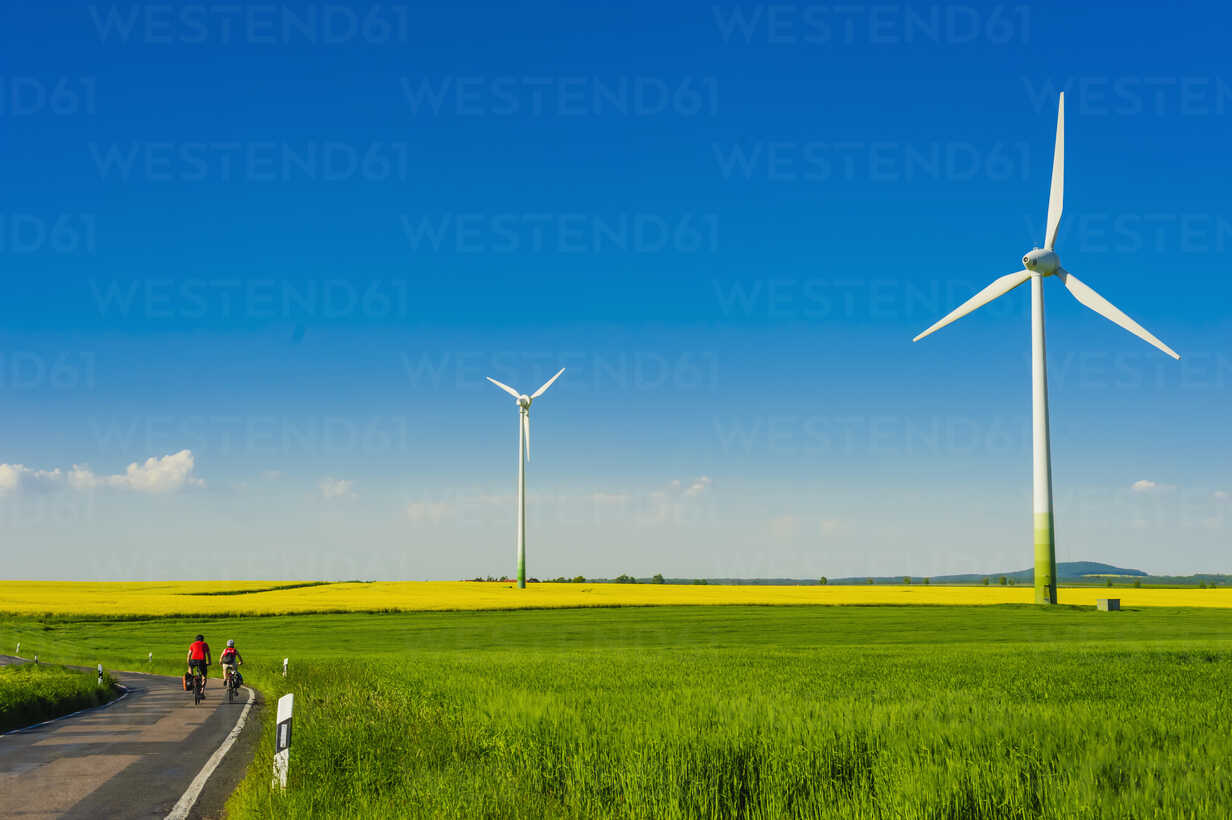 Germany, Saxony, Wind turbines in oilseed rape field - MJF000180 - Jana Mänz/Westend61