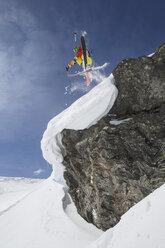 Austria, Tyrol, Mature man skiing in snow - FF001356