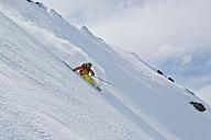 Austria, Tyrol, Mature man skiing in slope - FF001359
