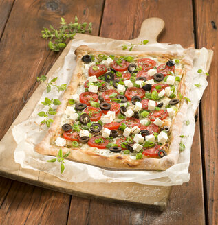 Tarte with tomato slice and feta cheese on pizza board - CH000055