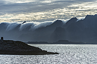 Norway, Clouds roll over mountains - HWO000014