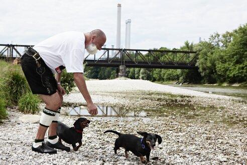 Germany, Bavaria, Munich, Senior man with dogs - ED000031