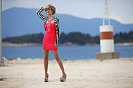 Greece, Young woman in red dress - AJF000011