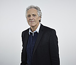 Portrait of senior man against white background, smiling - RH000194