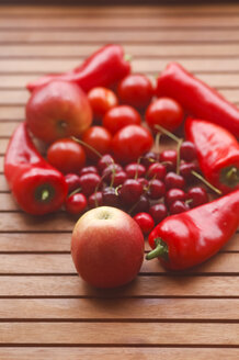 Germany, Varieties of fruits with red pointed pepper on wooden table, close up - JTF000443