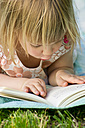 Germany, Baden Wuerttemberg, Girl reading book, close up - LVF000113