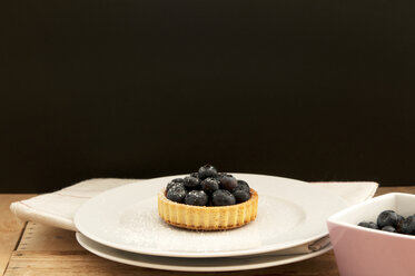 Fruit tartlet with blueberries on plate - OD000051